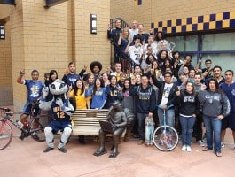 group-doing-zot-sign-(blue-and-gold)